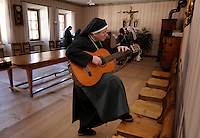 Nuns practice singing &quot;Happy Birthday&quot; to surprise one of their own at Val Mustiar is a world-famous Benedictine Convent of St. John in Switzerland.<br /> <br /> Val Mustiar is a world-famous Benedictine Convent of St. John, which is a UNESCO World Heritage Site.  The alpine monastery was founded by Charlemagne, was built in the 8th centruy, the church houses the world's richest and best preserved series of figuratives Romanesque murals with impressive Carolingian frescos..Since the 12th century the monastery is run by Benedictine nuns.  Eleven make their home behind closed walls, living a life of commitment to poverty and vcelebacy.  The nuns speak a variation of the Romanche language. The dialect changes from valley to valley from Mustair to St. Moritz.