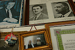 Pictures of Arab leaders are hung on a wall at Sheikh Abu Adnan's house, in Majdal Shams, Golan Heights. Top left is late Syrian president Hafez al-Assad; top right is late Egyptian president and Pan-Arabic leader Gamal Abdul Nasser; bellow left in the circle is Islamic Movement leader in Israel Sheikh Raed Salakh; below center is Sheikh Abu Adnan himelf, with a friend.