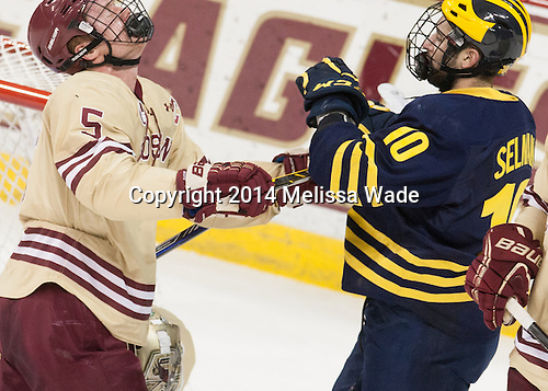 Michael Matheson (BC - 5), Justin Selman (Michigan - 10) - The Boston College Eagles defeated the visiting University of Michigan Wolverines 5-1 (EN) on Saturday, December 13, 2014, at Kelley Rink in Conte Forum in Chestnut Hill, Massachusetts.