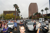 Phoenix, Arizona. April 25, 2012 - Souhbound view of Centrtal Avenue, moments after protesters blocked the street, disrupting rush hour traffic. About 500 people protested the controversial law on the same day U.S. Supreme Court justices heard legal arguments on the Arizona vs. United States case. At the end of the march, six activists blocked Central Avenue by sitting in the middle of the street. They all were arrested by the Phoenix Police Department and taken to the Fourth Avenue County Jail. Photo by Eduardo Barraza © 2012