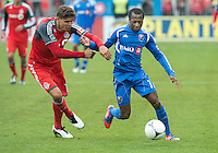 20 October 2012: Montreal Impact midfielder Sanna Nyassi #11 and Toronto FC defender Adrian Cann #12 in action during an MLS game between the Montreal Impact and Toronto FC at BMO Field in Toronto, Ontario Canada. .The ended in a 0-0 draw..