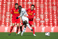 LIVERPOOL, ENGLAND - Easter Monday, April 1, 2013: Tottenham Hotspur's Shaquile Coulthirst in action against Liverpool's Krisztian Adorjan during the Under 21 FA Premier League match at Anfield. (Pic by David Rawcliffe/Propaganda)