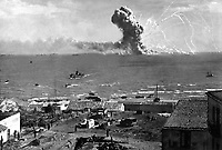 During the invasion of Sicily, an American cargo ship is hit by a bomb from a German plane and its cargo of munitions explodes, off Gela, Sicily, July 11, 1943.  Lt. Robert J. Longini.  (Army)<br /> NARA FILE #:  111-SC-180476<br /> WAR &amp; CONFLICT BOOK #:  1023