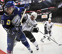 San Antonio Rampage center Jared Gomes tangles with Utica Comets right wing Alexandre Grenier, left, during an AHL hockey game, Monday, Jan. 13, 2014, in San Antonio. San Antonio won 3-2 in a shootout. (Darren Abate/AHL)
