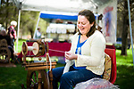 Oxford, CT- 23 April 2017-042317CM04-  Holly Pryor of Easton, spins Pygora Goat fiber during a spring fiber fest at the Twitchell-Rowland Homestead in Oxford on Sunday.  The event put on by the Oxford Historical Society featured wool preparation, including shearing, spinning, weaving and felting demonstrations.  The historic house was also open for demonstrations and tours.    Christopher Massa Republican-American