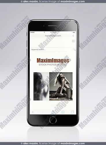 Apple iPhone 7 Plus with MaximImages stock photography website open on its display isolated on light gray background with clipping path