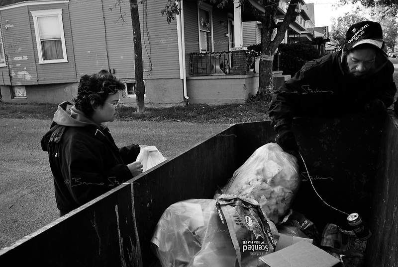 """Dayton, OH, October 29, 2008.Carlos, 40, and his girlfriend Karen, 38, pick up soda cans from garbage bins and make about 150$ a month selling them to a metal recycling company; they also share Karen' social security monthly allowance; they have voted for McCain, because """"he will make things better""""."""
