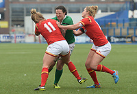 Ireland's Paula Fitzpatrick is tackled by Wales' Adi Taviner<br /> <br /> Photographer Ian Cook/CameraSport<br /> <br /> Women's Six Nations Round 4 - Wales Women v Ireland Women - Saturday 11th March 2017 - Cardiff Arms Park - Cardiff<br /> <br /> World Copyright &copy; 2017 CameraSport. All rights reserved. 43 Linden Ave. Countesthorpe. Leicester. England. LE8 5PG - Tel: +44 (0) 116 277 4147 - admin@camerasport.com - www.camerasport.com
