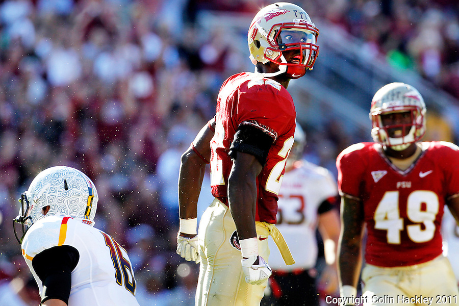 TALLAHASSEE, FL 10/22/11-FSU-MARY102211 CH-Florida State's Telvin Smith celebrates sacking Maryland quarterback C.J. Brown, left, for a 10 yard sack during first half action Saturday at Doak Campbell Stadium in Tallahassee. .COLIN HACKLEY PHOTO