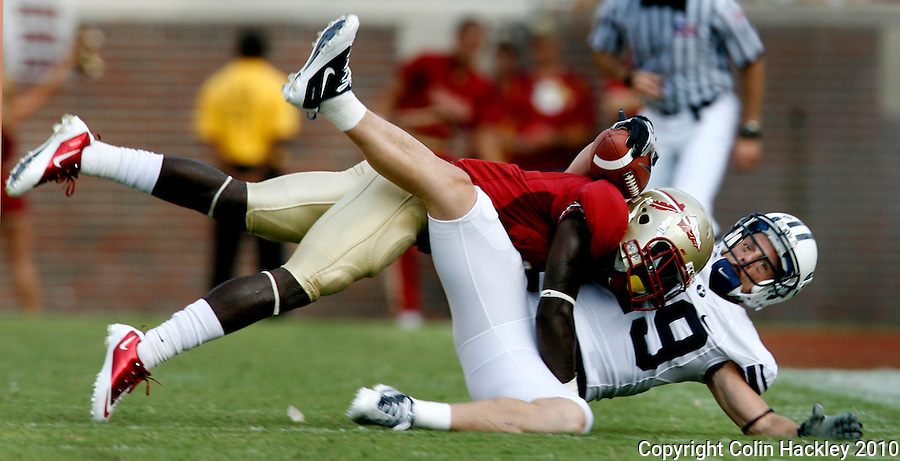 TALLAHASSEE, FL 9/18/10-FSU-BYU FB10 CH-Florida State's Mike Harris sends Brigham Young's Luke Ashworth to the turf during second half action Saturday at Doak Campbell Stadium in Tallahassee. The Seminoles beat the Cougars 34-10..COLIN HACKLEY PHOTO