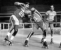 ROLLER DERBY ACTION: Eagles against the Chiefs..<br />#29 Eagles and #51 Chiefs..(1971 photo/Ron Riesterer)