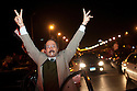 "Egyptians cheer and chant ""Freedom"" atop cars along the 6th of October bridge in downtown Cairo after hearing the news that Egyptian President Hosni Mubarak had stepped down February 11, 2011 following momentous marches on the public buildings across Cairo, Egypt. (Photo by Scott Nelson)"