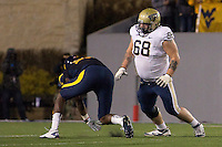 Pitt offensive tackle Jordan Gibbs (68). The WVU Mountaineers beat the Pitt Panthers 21-20 at Mountaineer Field in Morgantown, West Virginia on November 25, 2011.