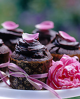 Sumptuous chocolate muffins decorated with pink ribbon and rose petals