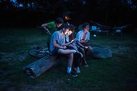 Screenagers Mitchell, Louis and Lucas.Barn, Bridgehampton, New York, USA