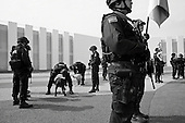 Mexico City, Mexico<br /> June 17, 2008<br /> <br /> Federal police prepare their anti-drug dogs at the new federal police center.