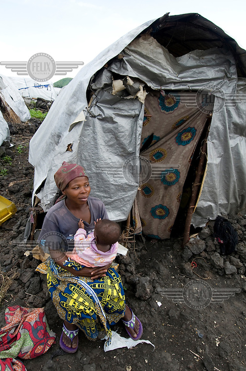 25 year old mother of four Furaha Maombi outside her shelter in the Mugunga I IDP (Internally Displaced Persons) camp.
