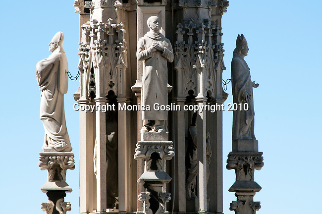 Statues carved on the spires on the roof of the Duomo (Cathedral) in Milan, Italy.