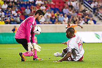 Houston Dynamo goalkeeper Tally Hall (1) makes a save on a shot by Thierry Henry (14) of the New York Red Bulls during a Major League Soccer (MLS) match at Red Bull Arena in Harrison, NJ, on August 10, 2012.