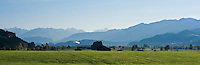 View towards village of Agathazell and mountains of the Allgäu region of southern Bavaria, Germany