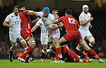 England's James Haskell pushes away Wales' Taulupe Faletau<br /> <br /> Photo by Ian Cook/CameraSport<br /> <br /> Rugby Union - RBS 6 Nations Championships 2015 - Wales v England - Friday 6th February 2015 - Millennium Stadium - Cardiff<br /> <br /> &copy; CameraSport - 43 Linden Ave. Countesthorpe. Leicester. England. LE8 5PG - Tel: +44 (0) 116 277 4147 - admin@camerasport.com - www.camerasport.com