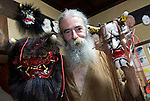 Briton Jake Davies poses for a photo with two of his Iwami-Kagura masks -- the female demon Hanya (R) and the Akaoni (red demon)  from Iwami-Kagura dance -- at his home in Sakurae Village, Shimane Prefecture, Japan on 28 June 2011..Photographer: Robert Gilhooly