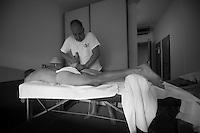 soigneur Gert Van Dommelen takes care of Lars Bak after stage 13 of the Giro2012