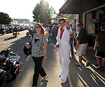 STURGIS, SOUTH DAKOTA - AUGUST 2010:  An Elvis Presley look-alike walks on Main Street in downtown Sturgis, South Dakota during the 70th annual Sturgis Motorcycle Rally held in the Black Hills.  The attendance estimates were placed between 500, 000 and 700,000 bikers.