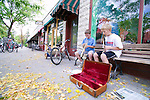 Two boys play thier wind instruments for donations in the Hyde Park neighborhood of Boise,  Idaho