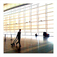 Airline employee moving equipment into place at JFK Airport, in NYC. (iPhone image)