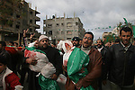 Palestinians carry the bodies of senior Hamas leader Nizar Rayyan and his family, who were killed in an Israeli air strike on their home on Thursday, during their funeral in Jabalya in the northern Gaza Strip.APAIMAGES PHOTO / Ashraf Amra