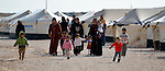 Women and children walking in the Zaatari Refugee Camp, located near Mafraq, Jordan. Opened in July, 2012, the camp holds upwards of 50,000 refugees from the civil war inside Syria. International Orthodox Christian Charities and other members of the ACT Alliance are active in the camp providing essential items and services.