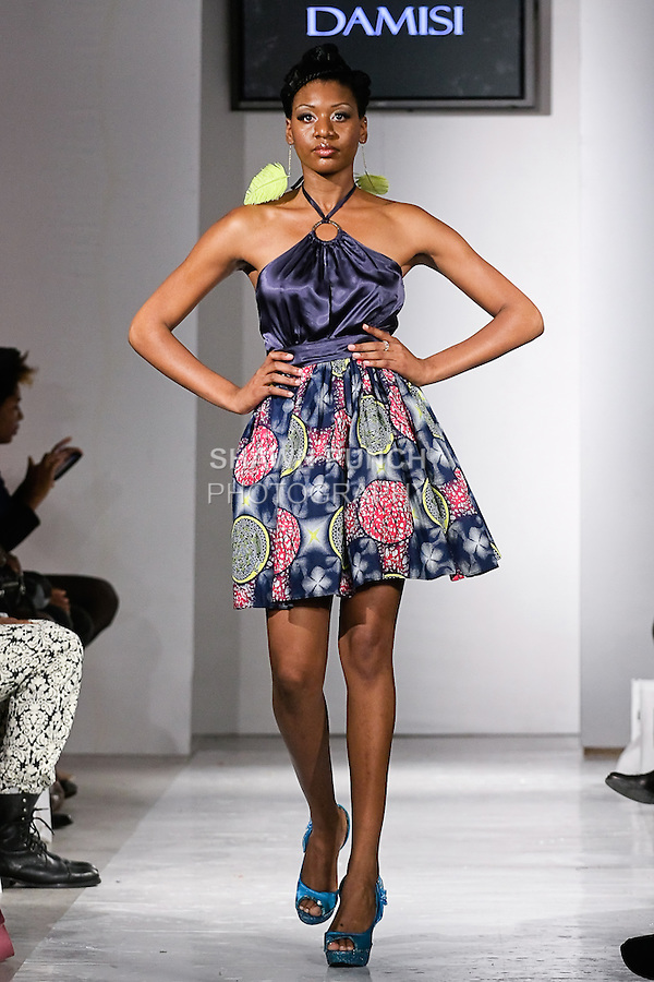 Model walks the runway in an outfit by Moriamo and Latifat Johnson for the Aso Damisi Spring Summer 2012 collection, during BK Fashion Weekend Spring Summer 2012.