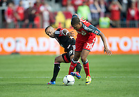 05 May 2012: D.C. United forward Maicon Santos #29 and Toronto FC midfielder Reggie Lambe #19 in action during an MLS game between DC United and Toronto FC at BMO Field in Toronto.