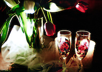 Red Roses and unique champagne classes complement one another in a still life from a wedding reception. (Photo by Scott Eklund/Red Box Pictures)