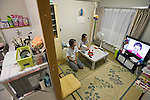 Minako Takahashi, 63, and her husband Takeshi (67) watch TV in their home in a temporary housing estate established for those who lost their homes during the March 11 quake and tsunami in Natori City, Miyagi Prefecture Prefecture, Japan on 08 Sept. 2011.  Photograph: Robert Gilhooly
