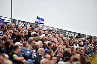 A Bath fan waves a Bath Rugby flag in support in the Dyson Stand. West Country Challenge Cup match, between Bath Rugby and Exeter Chiefs on October 10, 2015 at the Recreation Ground in Bath, England. Photo by: Patrick Khachfe / Onside Images