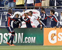 New England Revolution forward Saer Sene (39) celebrates his goal with teammates. In a Major League Soccer (MLS) match, the New England Revolution tied Chivas USA, 3-3, at Gillette Stadium on August 29, 2012.