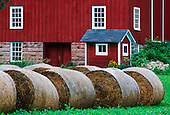 Hay bales and a red barn, Central Ohio, USA.