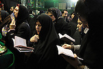 An group of women read special prayer about Imam Hussein inside a Hosseinye a special place for pray and cry during the month of Moharram.