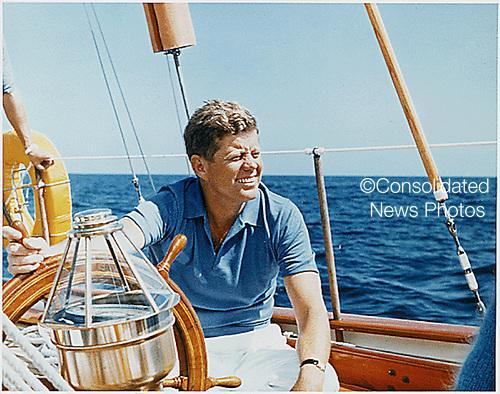 Narragansett Bay, RI -- United States President John F. Kennedy at the wheel of the Coast Guard Yacht &quot;Manitou&quot; on Narragansett Bay, RI on August 26, 1962<br /> Mandatory Credit: Robert Knudsen/White House via CNP