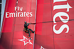 Emirates Team New Zealand sailing the AC72 on the Hauraki Gulf on the second day of sailing. A bang brings an end to sailing as a part in the wing gives way.Richard Meacham goes aloft to check the damage and take some photos for the designers. 3/8/2012