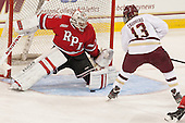 Jason Kasdorf (RPI - 33) stops Johnny Gaudreau (BC - 13). - The Boston College Eagles defeated the visiting Rensselaer Polytechnic Institute Engineers 7-2 on Sunday, October 13, 2013, at Kelley Rink in Conte Forum in Chestnut Hill, Massachusetts.