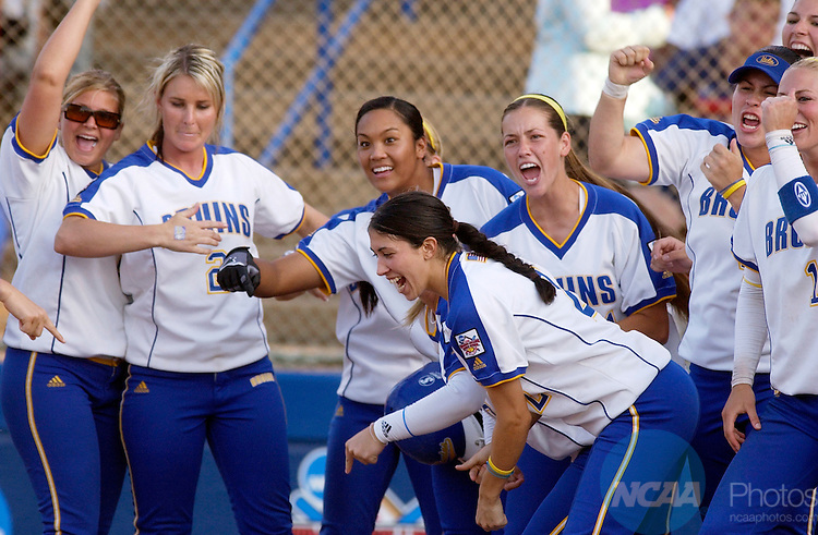 06 JUNE 2005:  UCLA celebrates a homerun by Caitlin Benyi against Jennifer Ritter (15) of the University of Michigan during game two of the Division I Women's Softball Championship held at Don E. Porter ASA Hall of Fame Stadium in Oklahoma City, OK.  Michigan won game two with a 5-2 victory.  Stephen Pingry/NCAA Photos