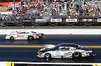 Jul. 28, 2013; Sonoma, CA, USA: NHRA pro stock driver Greg Anderson (far lane) races alongside Vincent Nobile during the Sonoma Nationals at Sonoma Raceway. Mandatory Credit: Mark J. Rebilas-
