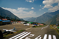 "Tenzing-Hillary Airport. In January 2008, the Lukla airport was renamed in honor of Sir Edmund Hillary and Sherpa Tenzing Norgay, the first persons to reach the summit of Mount Everest. The mountain terrain, thin air, unpredictable weather, and the airport's short, sloping runway make it one of the most challenging landings in the world. The History Channel ranked it as the ""most extreme"" airport in the world."