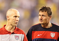 Head coach bob Bradley talk to Lubos Kubik of the USA during an international friendly match against Brazil in Giants Stadium, on August 10 2010, in East Rutherford, New Jersey.Brazil won 2-0.