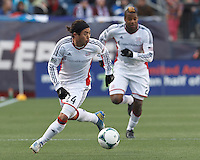 New England Revolution midfielder Lee Nguyen (24) on the attack.   In a Major League Soccer (MLS) match, Sporting Kansas City (blue) tied the New England Revolution (white), 0-0, at Gillette Stadium on March 23, 2013.