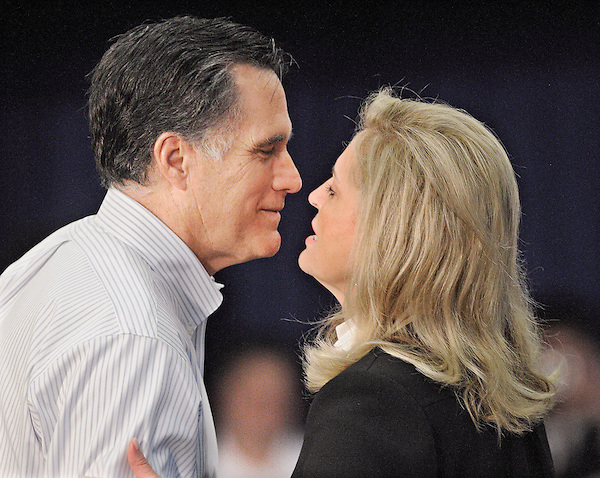 Bexley, Ohio: February 29, 2012<br /> <br /> Presidential candidate Mitt Romney exchanges a kiss with his wife Ann Romney after she introduces him at campaign event at Capital University. Romney said during a Q&amp;A, &quot;By far the most important thing in my life is my wife. Ann and I fell in love young. We're still in love. We have a marriage that is still filled with love. And her happiness is my happiness. I care more about that than anything in the world.&quot; He is running a second time for the presidency. &copy;Christopher Fitzgerald / CandidatePhotos.