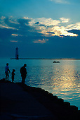 Fishermen near the Frankfort North Breakwater Lighthouse, Lake Michigan, Frankfort, Michigan.